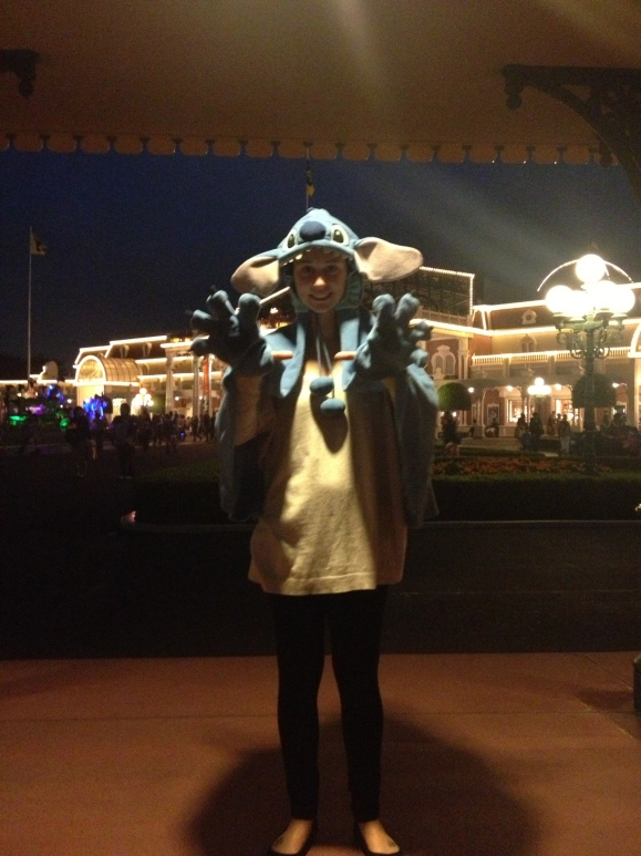 Me at Disneyland without proper pants. Also I am dressed in a Stitch cape. I can't believe I am showing the world this.